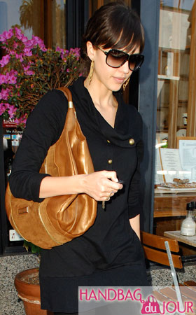 http://handbagdujour.com/wp-content/uploads/2009/03/jessica-alba-jimmy-choo-mandah-shiny-leather-and-suede-handbag.jpg