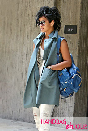 a8a8a5588b20 Rihanna Does Hawaii Donning Her New Blue Gucci Darwin Backpack ...
