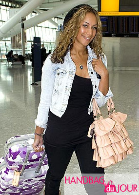 Leona Lewis loves her pink and black Deux Lux ruffle bucket bags