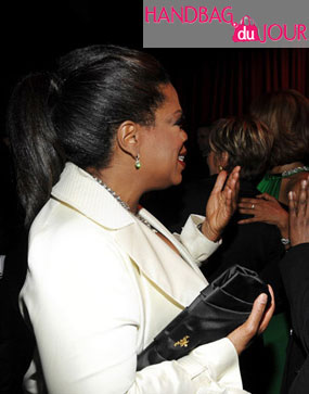 Oprah Winfrey Carries the Prada Raso A Clutch at Time Magazine's 100 Most Influential People