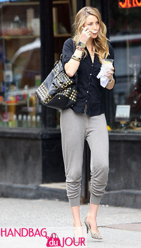Sucks in The City: Whitney Port on set with her Rebecca Minkoff Stud Devote belted tote