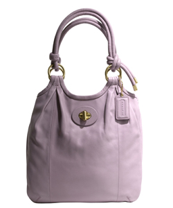 Isla Fisher with Coach's new Parker Slim Tote mauve