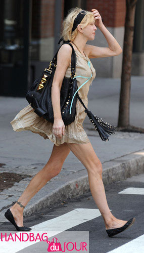 Courtney Love and her black studded leather handbag hit the streets of Manhattan