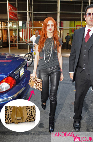 Melrose Place Ashlee Simpson on the streets of New York city leather pants rocker tee jimmy choo martha leopard print clutch
