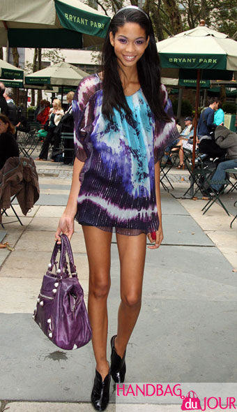 supermodel model Chanel Iman commands the sidewalk with Balenciaga bryant park fashion week new york tents balenciaga purple bag