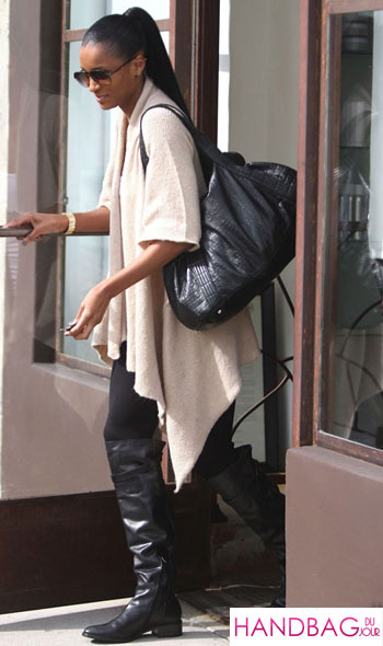 Ciara 'works' her boots and black shoulder bag