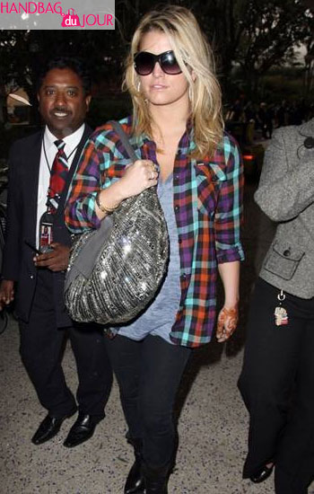 Jessica Simpson silver metallic Valentino 360 bag Los Angeles International Airport after returning home from a trip to Mumbai, India