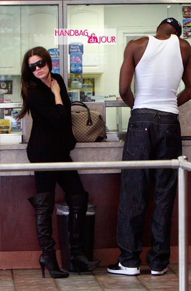 Khloe Kardashian and LA Lakers Lamar Odom canvas Gucci bag over-the-knee black high-heeled boots