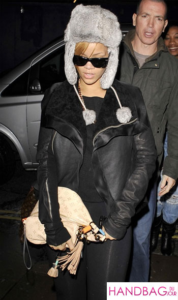 Rihanna lands in London with her Louis Vuitton black eye bruise on eye BFF Melissa sunglasses trapper hat