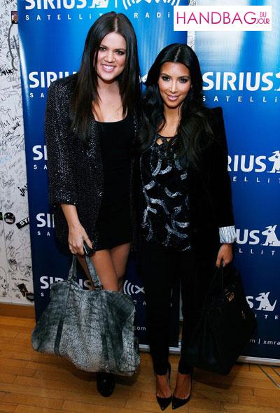 Khloe and Kim Kardashian pub their show on Sirius radio with Alexander Wang's Daphne Duffel bag