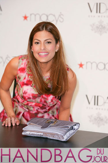Guess her bag: Eva Mendes' pleated grey foldover clutch at Vida for España launch