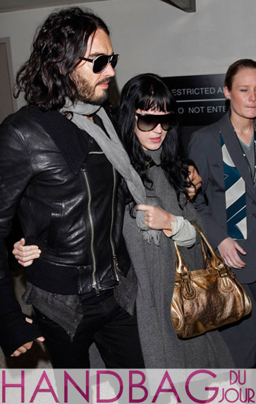Katy Perry jetsets with Russell Brand and her gold Chloe Paddington bag LAX