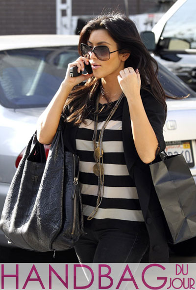 Kim Kardashian totes a brand new bag - the Givenchy Large Elschia Sac