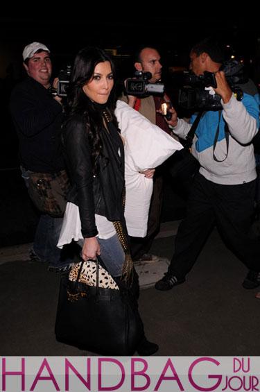 Kim Kardashian and her Hermes Birkin, haute off the (LAX) runway