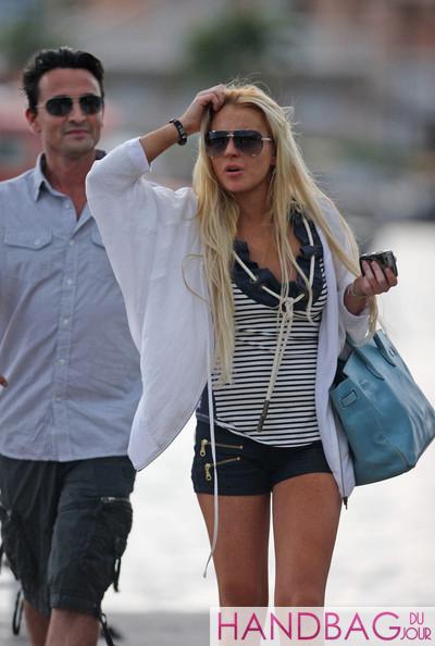 Lindsay Lohan in St. Barts with her Hermes Hermès denim Blue Jean Clemence Leather 30cm Birkin Bag