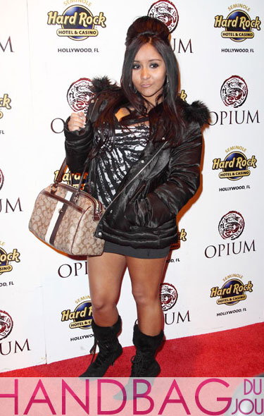 Nicole 'Snooki' Polizzi flaunts her 'celebrity' and her Coach bag