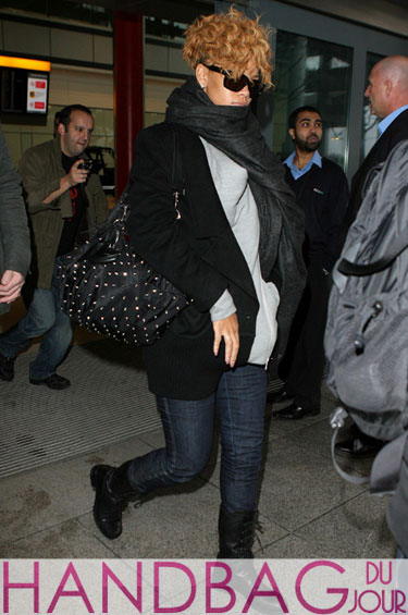 Rihanna on her way to 'Help for Haiti' with her Givenchy Nylon Small New Sacca Top handle spike stud bag