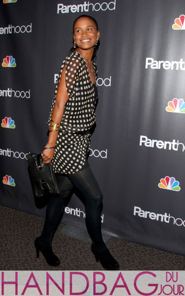 Joy Bryant on the red carpet with the Botkier Isis clutch Parenthood premiere at the Director's Guild Theater in Los Angeles