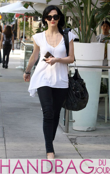 Ashlee Simpson dons new black hairdo and a black Balenciaga Arena Classic Pompon bag