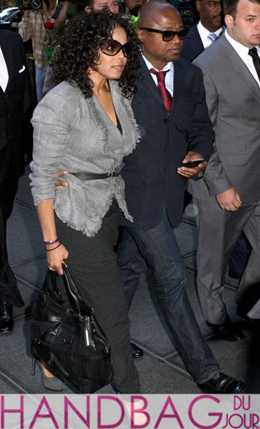 Janet Jackson heads to court with the fam and her Alexander McQueen Faithful Large Tote