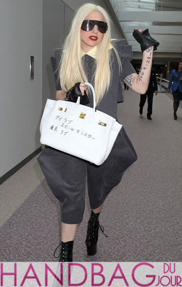 Gasp Lady Gaga defaces the almighty white Hermes Birkin Tokyo Japan black sharpie marker