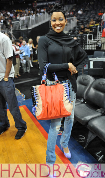 R&B singer Monica was spotted courtside at the Los Angeles Lakers vs. Atlanta Hawks game at Philips Arena on March 31, 2010 in Atlanta, Georgia handbag keri hilson