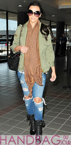 Kim Kardashian flies with her friends - quilted Chanel Flap bag and Balmain black lace-up leather ankle boots