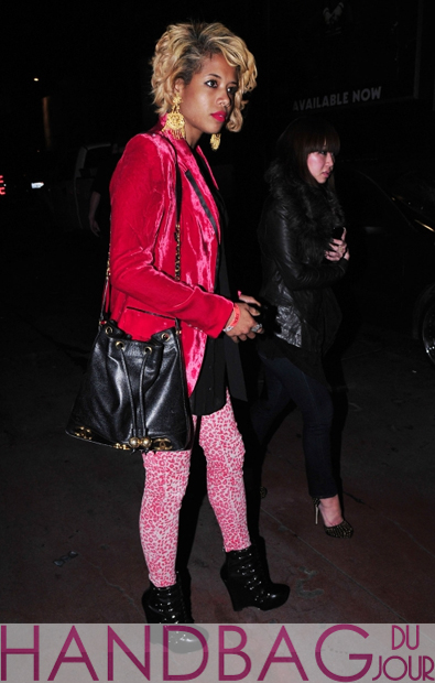 Kelis channels a little bit of Prince and carries Chanel drawstring shoulder bag