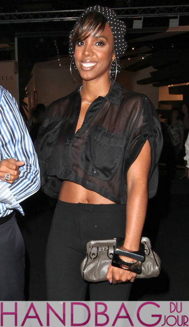 Kelly Rowland with a mystery man and the MCM Nuovo Notte Metallic Chain Strap Clutch