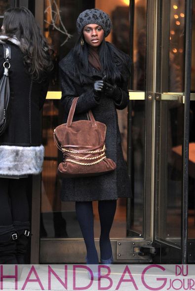 Tika-Sumpter-on-set-of-Gossip-Girl-brown-suede-chain-belt-bag