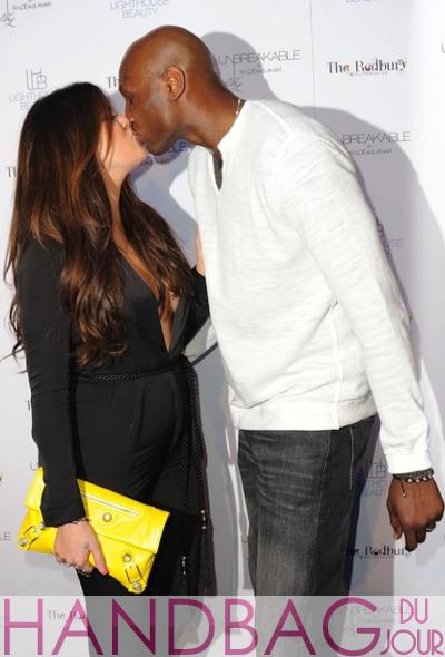 Khloe-Kardashian-Lamar-Odom-yellow-Balenciaga-Giant-Envelope-clutch