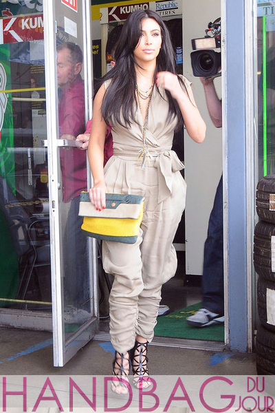 Kim-Kardashian-multicolored-Balenciaga-Boxwood-clutch-1 khaki Malandrino jumpsuit and Givenchy Bird Cage Booties