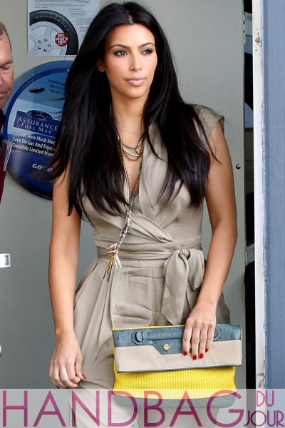 Kim-Kardashian-multicolored-Balenciaga-Boxwood-clutch-3 khaki Malandrino jumpsuit and Givenchy Bird Cage Booties