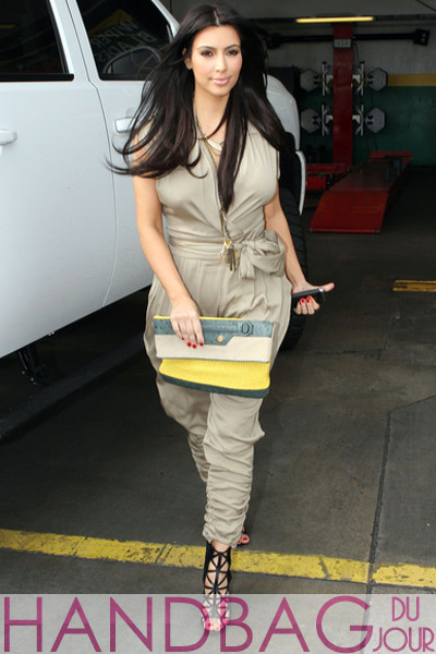Kim-Kardashian-multicolored-Balenciaga-Boxwood-clutch-4 khaki Malandrino jumpsuit and Givenchy Bird Cage Booties