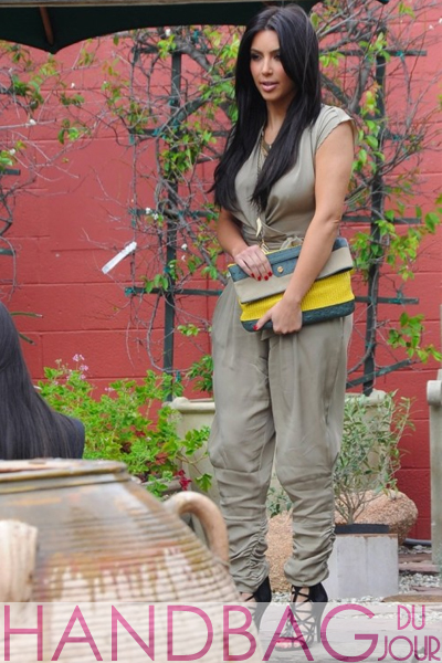 Kim-Kardashian-multicolored-Balenciaga-Boxwood-clutch-5 khaki Malandrino jumpsuit and Givenchy Bird Cage Booties
