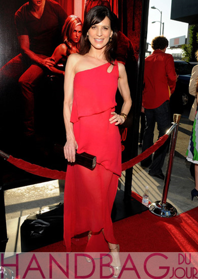 Perrey-Reeves-wearing-a-M.C.L.-By-Matthew-Campbell-Laurenza-Jackie-wood-handbag-to-the-HBO-Premiere-of-True-Blood-Season-4-at-ArcLight-Cinemas-Cinerama-Dome-on-June-21,-2011-in-Hollywood,-California.