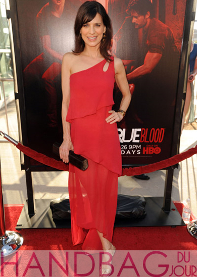 Perrey-Reeves-wearing-a-M.C.L.-By-Matthew-Campbell-Laurenza-Jackie-wood-handbag-to-the-HBO-Premiere-of-True-Blood-Season-4-at-ArcLight-Cinemas-Cinerama-Dome-on-June-21,-2011-in-Hollywood,-California.2
