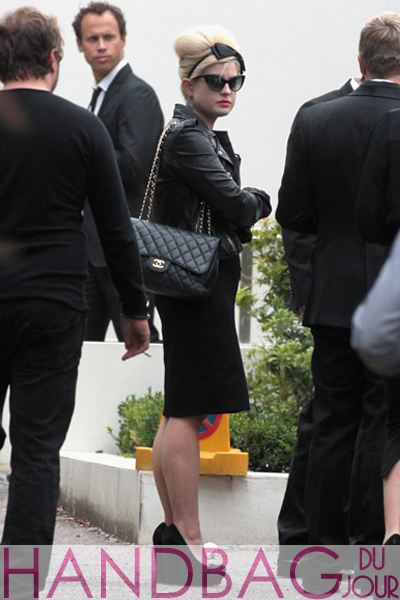 Kelly-Osbourne-attends-the-wake-of-singer-Amy-Winehouse-at-Southgate-Centre-For-Judaism-on-July-26,-2011-in-London,-England Chanel Flap bag