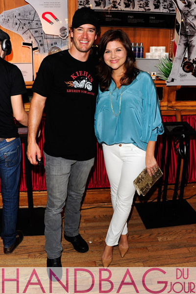 Actors-Mark-Paul-Gosselaar-and-Tiffani-Thiessen-pose-inside-during-Kiehl's-LifeRide-for-amfAR-Block-Party-at-Kiehl's-Since-1851-New-York-Flagship-Store-on-August-6,-2011-in-New-York-City.-snake-print-clutch