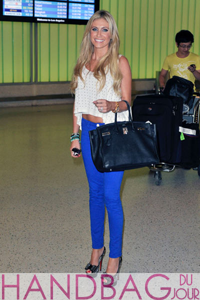 Claudine-Keane-and-Robbie-Keane-arrive-at-Los-Angeles-International-Airport-on-August-18,-2011-in-Los-Angeles,-California.