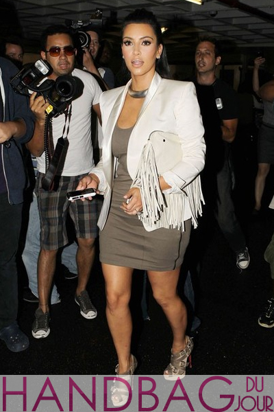 Kim-Kardashian-arriving-at-a-Beverly-Hills-nail-salon-for-a-pre-wedding-manicure-and-pedicure-Linea-Pelle-white-Fringe-clutch