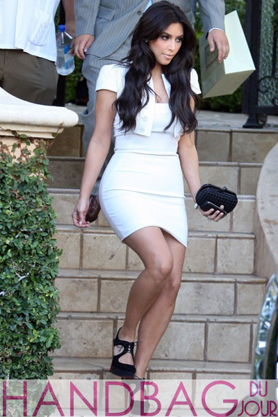 Kim-Kardashian-spotted-heading-out-to-wedding-rehearsals-with-the-Bottega-Veneta-'Knot'-Intrecciato-Clutch