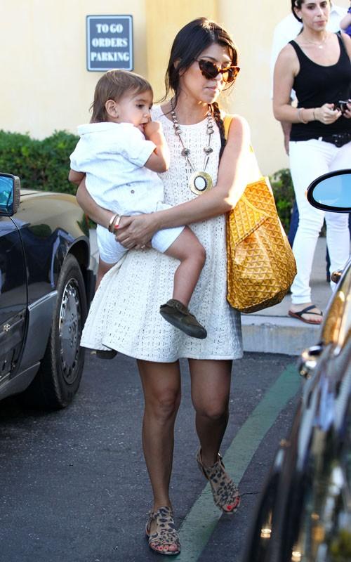 Kourtney Kardashian Mason in Calabasas, CA with yellow Goyard bag
