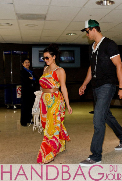 Kris-Humphries-and-Kim-Kardshian-with-her-Chanel-fringe-shoulder-bag,-returning-from-their-short-honeymoon-in-Italy