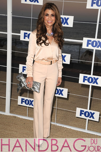 Paula-Abdul-attends-the-Fox-All-Star-Party-2011-at-Gladstone's-Malibu-on-August-5,-2011-in-Malibu,-California.-Valentino-silver-bow-clutch