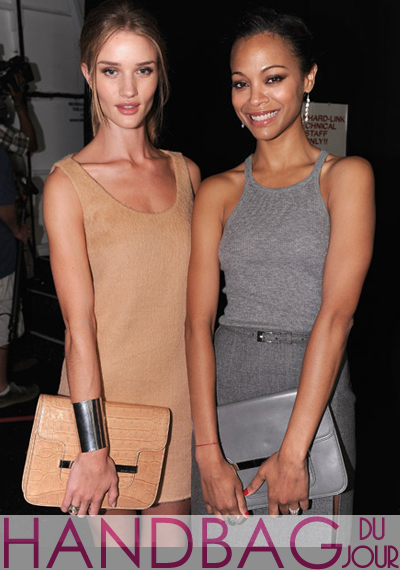 Actresses-Zoe-Saldana-and-Rosie-Huntington-Whiteley-pose-with-their-matching-Michael-Kors-handbags,-backstage-at-the-Michael-Kors-Spring-2012-fashion-show-at-Mercedes-Benz-Fashion-Week-closeup