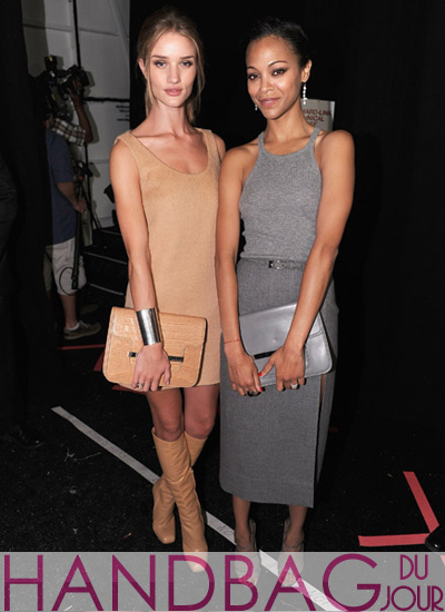 Actresses-Zoe-Saldana-and-Rosie-Huntington-Whiteley-pose-with-their-matching-Michael-Kors-handbags,-backstage-at-the-Michael-Kors-Spring-2012-fashion-show-at-Mercedes-Benz-Fashion-Week
