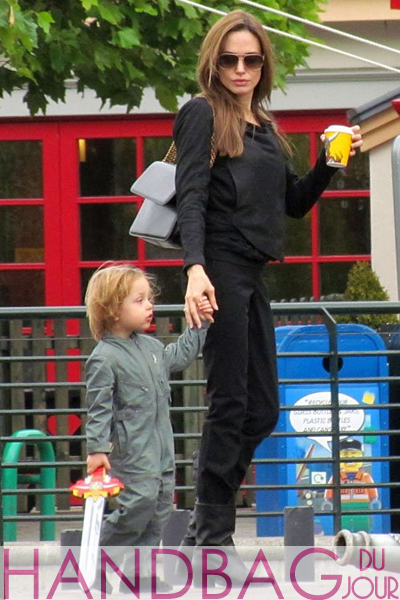 Angelina-Jolie-carrying-the-Stella-McCartney-Grace-Bag-from-the-Winter-11-collection,-in-Windsor,-UK