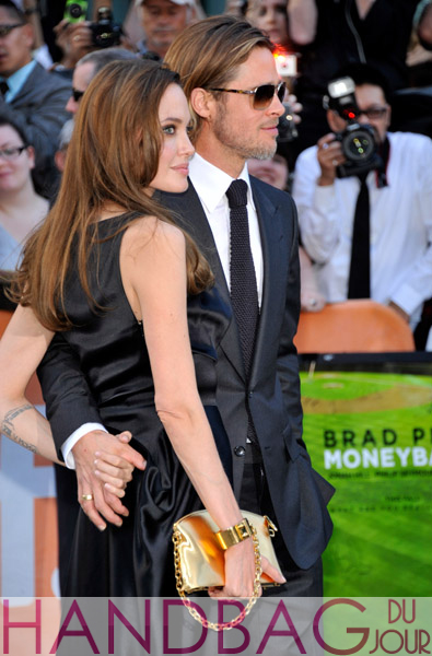 Brad-Pitt-and-Angelina-Jolie-with-gold-$15,000-Louis-Vuitton-Lockit-PM-Devotion-handcuff-clutch-handbag-at-Moneyball-premiere-at-the-2011-Toronto-International-Film-Festival-in-Toronto,-Canada-side-view