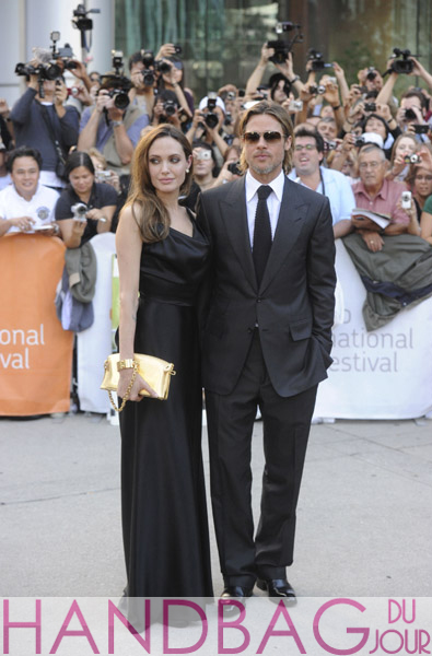 Brad-Pitt-and-Angelina-Jolie-with-gold-$15,000-Louis-Vuitton-Lockit-PM-Devotion-handcuff-clutch-handbag-at-Moneyball-premiere-at-the-2011-Toronto-International-Film-Festival-in-Toronto,-Canada